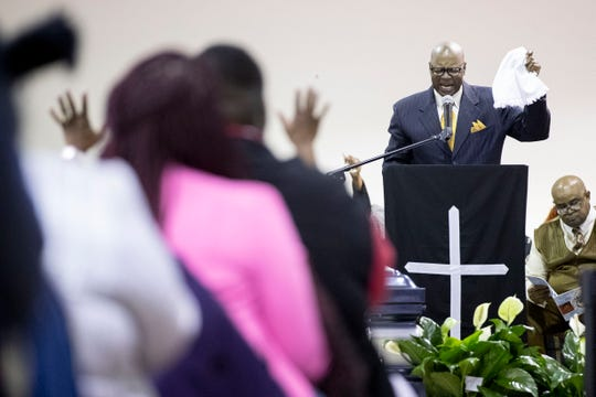 The Rev. James Rosser leads a prayer during the funeral on Saturday.