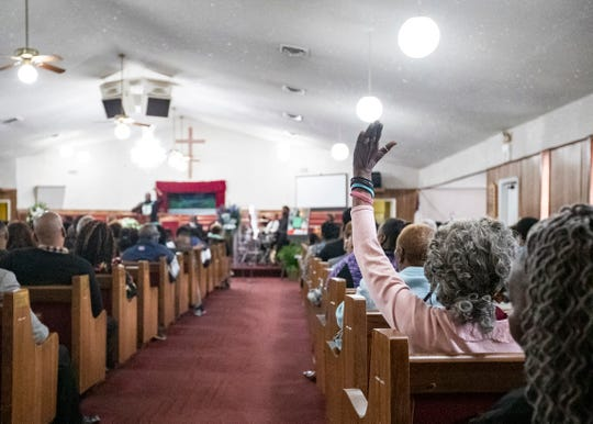Mourners gather inside the sanctuary of New Life Missionary Baptist Church on Saturday.