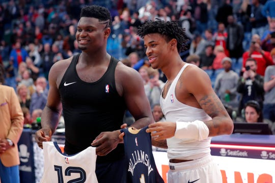 New Orleans Pelicans forward Zion Williamson, left, and Memphis Grizzlies guard Ja Morant exchange jerseys after an NBA basketball game in New Orleans, Friday, Jan. 31, 2020. The Pelicans won 139-111. (AP Photo/Gerald Herbert)