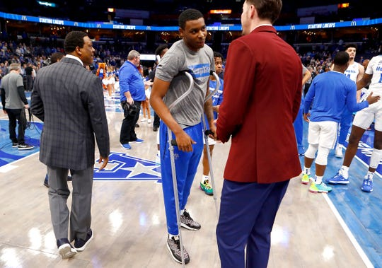 Memphis Tigers forward D.J. Jeffries talks to Assistant Coach Mike Miller before their game against the Connecticut Huskies at the FedExForum on Saturday, Feb. 1, 2020. Jeffries is expected to miss 4-6 weeks with a partially torn posterior cruciate ligament in his left knee.