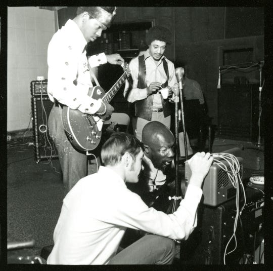 Harold Beane, with guitar, working with Isaac Hayes.