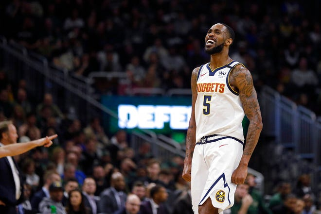 Denver Nuggets' Will Barton reacts after making a shot during the second half of the team's NBA basketball game against the Milwaukee Bucks on Friday, Jan. 31, 2020, in Milwaukee. (AP Photo/Aaron Gash)