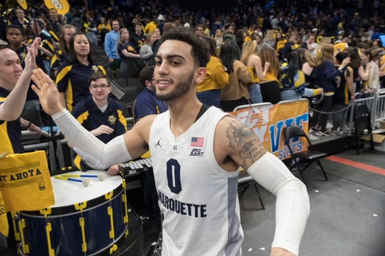 Marquette guard Markus Howard high-fives fans after the Golden Eagles' win over DePaul.    MARK HOFFMAN/MILWAUKEE JOURNAL SENTINEL
