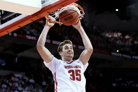 Nate Reuvers of the Badgers throws home a dunk during the second half against Michigan State.