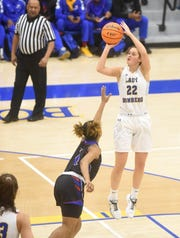 Mountain Home's Kate Gilbert launches a jumper against West Memphis on Friday night.