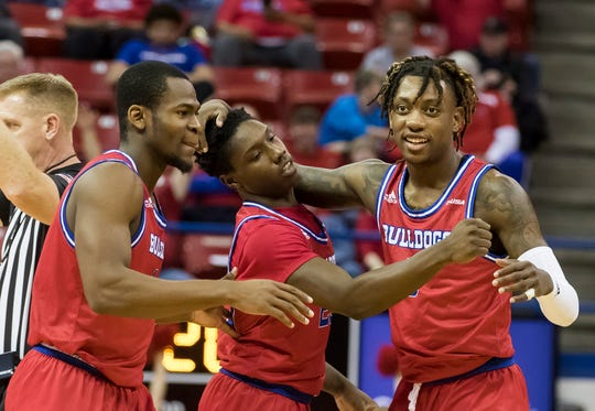 Louisiana Tech teammates Derric Jean (1), left, and Amorie Archibald (3), right, celebrate Daquan Bracey's (25) 3 point basket and extra foul shot during the game against Old Dominion at Thomas Assembly Center in Ruston, La. on Feb. 1.