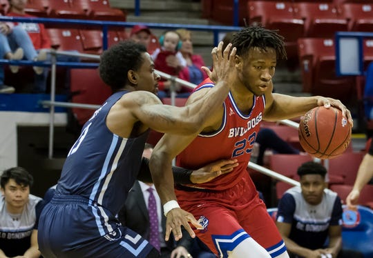 Old Dominion University's Aaron Carver (13) attempts to guard Louisiana Tech's Mubarak Muhammed (23) during the basketball game at Thomas Assembly Center in Ruston, La. on Feb. 1.