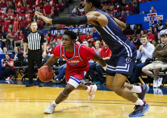 Louisiana Tech's Daquan Bracey (25) attempts to beat Old Dominion's Aaron Carver (13) along the baseline during the game at Thomas Assembly Center in Ruston, La. on Feb. 1.