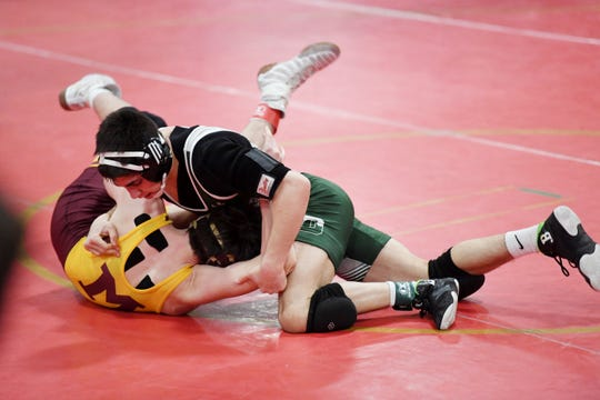Nicholas Nardone of Delbarton (right) wrestles Thomas Packie of Madison in a 126-pound match on the first day of the Morris County Tournament at Mount Olive High School on Friday, January 31, 2020.