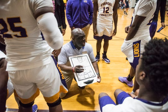 Evangel coach Kerwin Washington talks with his team during a break in the action at Evangel Christian Academy in Montgomery, Ala., on Friday, Jan. 31, 2020.