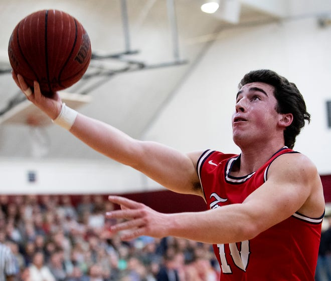 Trinity's Will Aaron (10) shoots against Montgomery Academy on the MA campus in Montgomery, Ala., on Friday January 31, 2020.