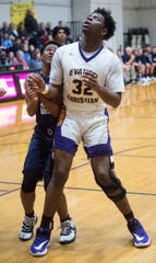Evangel's Jakolvian Johnson (32) wears a knee-brace as his team takes on Eastwood at Evangel Christian Academy in Montgomery, Ala., on Friday, Jan. 31, 2020.