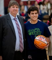 Montgomery Academy coach Jeremy Arant presents  Oliver Bear (1) with a ball for hitting his 1000th point earlier in the season before the Trinity game on the MA campus in Montgomery, Ala., on Friday January 31, 2020.