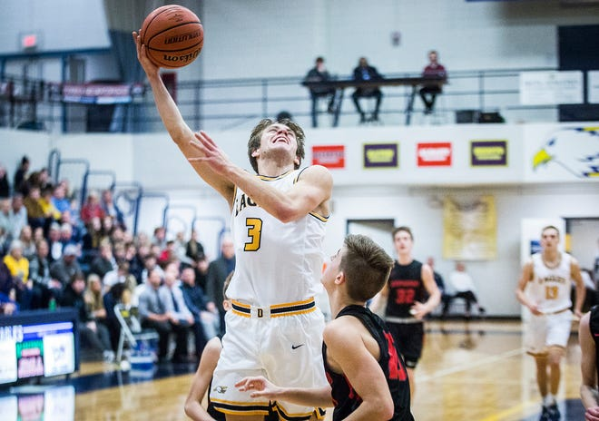 FILE -- Delta senior Zach Garner goes up for a shot against Wapahani during a game played at Delta High School Friday, Jan. 31, 2020.