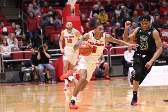 Ball State junior guard Ishmael El-Amin pushes the ball up the floor Saturday during BSU's game against Ohio. The Cardinals won the matchup.