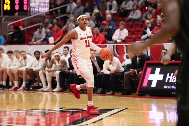 Ball State redshirt freshman guard Jarron Coleman dribbles the ball up the floor Saturday during BSU's game against Ohio. The Cardinals won the matchup.