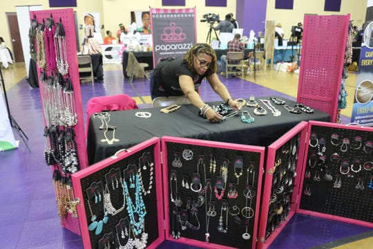 P. Ronnie Benson with Paparazzi sets up her jewelry at the Nashville Black Market on Feb. 1, 2020.