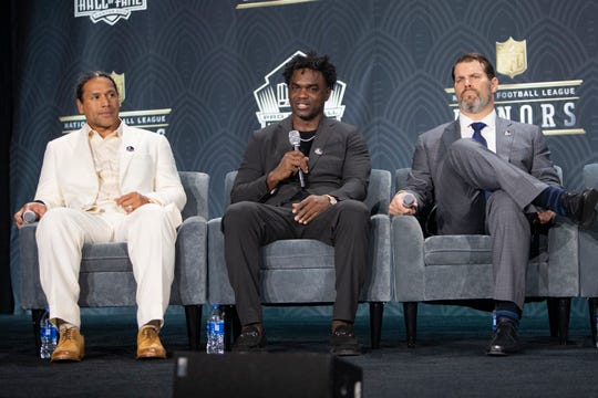 Troy Polamalu, left, Edgerrin James and Steve Hutchinson, attend a press conferences after being selected as new members of the Football Hall of Fame, Saturday, Feb. 1, 2020, at the Adrienne Arsht Center for the  Performing Arts in Miami.