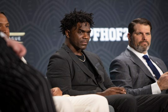 Edgerrin James is flanked by Troy Polamalu, left, and Steve Hutchinson, right, during a press conference, Saturday, Feb. 1, 2020, at the Adrienne Arsht Center for the Performing Arts in Miami.