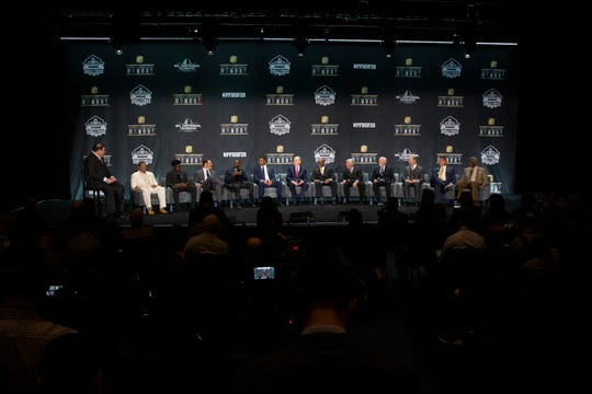 The class of 2020 Football Hall of Fame inductees sit together for a press conference, Saturday, Feb. 1, 2020, at the Adrienne Arsht Center for the Performing Arts in Miami.