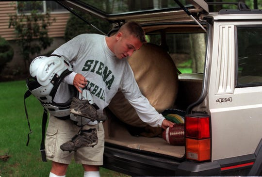 Jeff Hafley of Montvale is packing to leave for football camp before his senior year at Siena College in New York. Saphan Pickett/The Record
