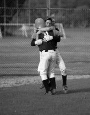 Jeff Hafley scored the winning run for Pascack Hills during a 1997 baseball game.