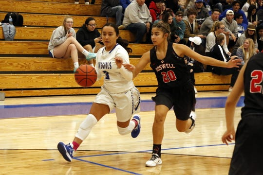 Carlsbad's Dominique Chacon drives the lane for against Roswell on Jan. 31, 2020. Carlsbad won, 42-17.
