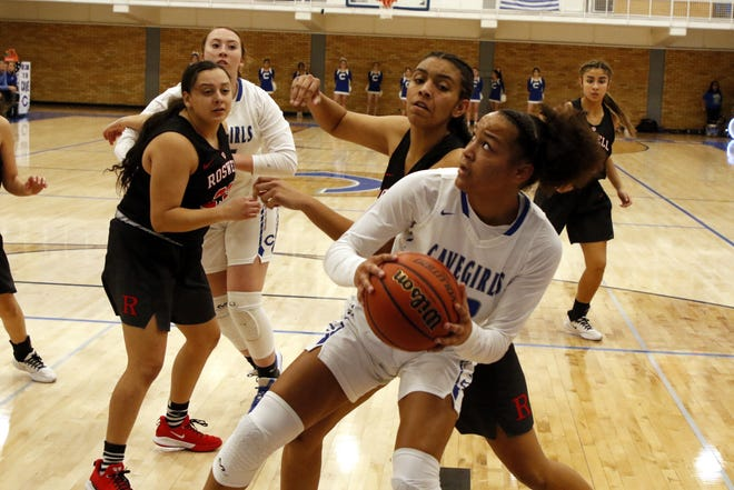 Carlsbad's Allie Myers goes for a contested shot against Roswell on Jan. 31, 2020. Myers led all scorers with 18 points. Carlsbad won, 42-17.