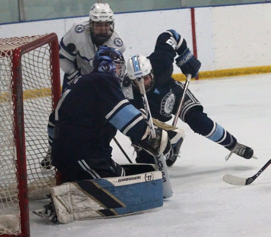Stevenson goalie Brenden Stroble keeps the puck tight to his left pad as Salem applies some pressure.