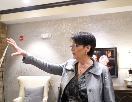 Sue Vincent, executive director of Bickford Canton, leads a tour of the assisted living care facility in Canton on Jan. 31.