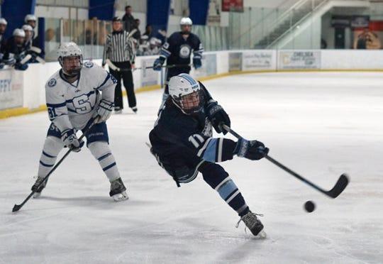 Stevenson Spartan Dominic Glenn takes an off-balanced, on-one-skate shot against the Salem High goal.