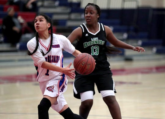 Indio's Vianay Gonzales drives to the basket against Banning's Amani Anderson in Indio, Calif., on Friday, January 31, 2020.