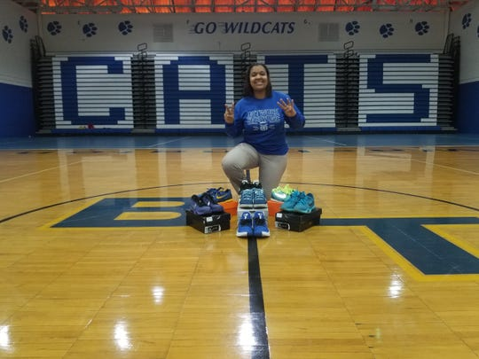 Booker T. Washington head coach Jade Brown displays her collection of seven Kobe Bryant signature sneakers in the Washington High gym.