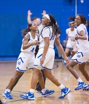 Janelle Jones (10) and teammates celebrate their overtime victory during the PHS vs Washington girls basketball at Booker T. Washington High School in Pensacola on Friday, Jan. 31, 2020.