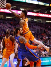 Suns' Kelly Oubre (3) draws a blocking foul from Thunder's Steven Adams (12) during the first half at the Talking Stick Resort Arena in Phoenix, Ariz. on January 31, 2020.