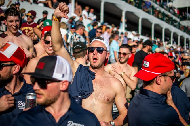 Rowdy fans in a bachelor party boo golfers at the 16th hole at the Waste Management Phoenix Open in Scottsdale on Friday, Jan. 31, 2020.