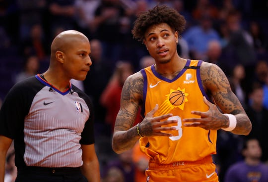 Suns' Kelly Oubre Jr. (3) argues with an official over an apparent lane violation during the second half against the Thunder at the Talking Stick Resort Arena in Phoenix, Ariz. on January 31, 2020.