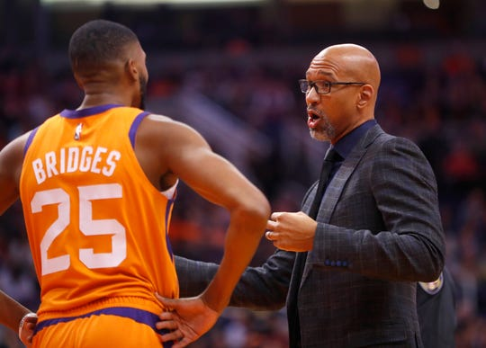 Suns' head coach Monty Williams talks with Mikal Bridges (25) during the first half against Oklahoma City at the Talking Stick Resort Arena in Phoenix, Ariz. on January 31, 2020.