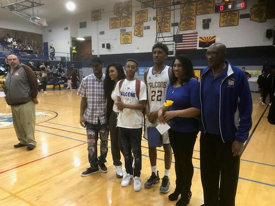 Carl Hayden High School celebrates the final home game for longtime basketball coach Argie Rhymes.