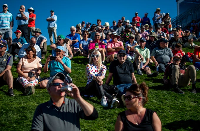 Fans watch golf at the 18th hole at the Waste Management Phoenix Open in Scottsdale on Friday, Jan. 31, 2020.
