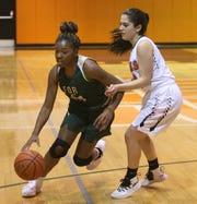 Franklin D. Roosevelt senior Jaelen Daubon drives to the basket against a Marlboro defender during a Jan. 31 girls basketball game.