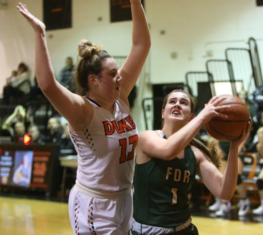 FDR's Kelsea Demelis gets tough coverage from Marlboro's Erin Lofaro during Friday's game on January 31, 2020.