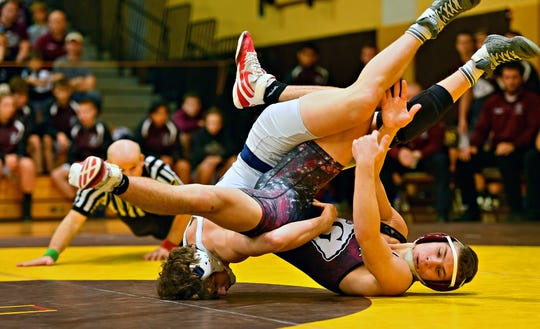 Dallastown's Brooks Gable, left, and Gettysburg's Luke Sainato wrestle in the 152 pound weight class during District 3, Class 3A Team Wrestling Championship action at Milton Hershey School in Hershey, Saturday, Feb. 1, 2020. Gable would win by decision 4-0 and Gettysburg would win the Championship 33-22. Dawn J. Sagert photo