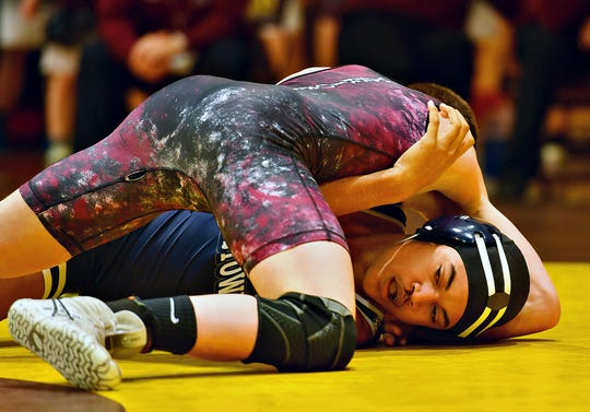 Dallastown's Jordan Brabham, right, and Gettysburg's Dylan Reinert wrestle in the 185 pound weight class during District 3, Class 3A Team Wrestling Championship action at Milton Hershey School in Hershey, Saturday, Feb. 1, 2020. Reinert would pin Brabham at 1:18 and Gettysburg would win the Championship 33-22. Dawn J. Sagert photo
