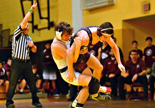 Dallastown's Brooks Gable, left, and Gettysburg's Luke Sainato wrestle earlier this season. Gable owns a 31-5 record entering sectional acton this weekend. He is one of four York-Adams League wrestlers with at least 30 wins this season. Dawn J. Sagert photo
