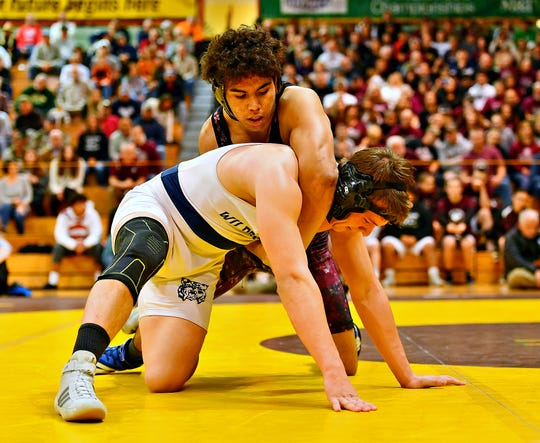 Dallastown's Andrew Smith, front, and Gettysburg's Samuel Rodriguez wrestle in the 220 pound weight class during District 3, Class 3A Team Wrestling Championship action at Milton Hershey School in Hershey, Saturday, Feb. 1, 2020. Rodriguez would win by major decision 12-3 and Gettysburg would win the Championship 33-22. Dawn J. Sagert photo