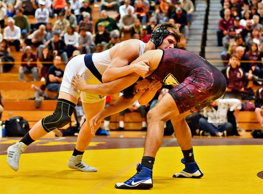 Dallastown's Andrew Smith, left, and Gettysburg's Samuel Rodriguez wrestle in the 220 pound weight class during District 3, Class 3A Team Wrestling Championship action at Milton Hershey School in Hershey, Saturday, Feb. 1, 2020. Rodriguez would win by major decision 12-3 and Gettysburg would win the Championship 33-22. Dawn J. Sagert photo