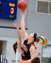 Emily Prowell (42) wins the tip-off during the YAIAA girls basketball game between Dallastown and Central York at Dallastown Area High School, January 31, 2020. The Panthers defeated the Wildcats 35-29.