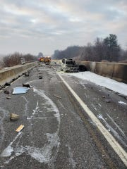 Crews clean up after a crash and fire Saturday morning along Interstate 83 North near the Shrewsbury interchange.