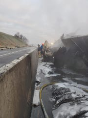 Firefighters work at the scene of the crash on I-83. The highway was shut down for hours after a tractor-trailer crashed and ruptured its diesel tanks. The fuel ignited on the highway.